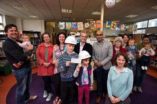 Lightbox director Neville De Souza (fourth from left on back row)  presented the cheque to Upper Norwood Library trustees, including children's librarian Fiona Byers (kneeling at the front)