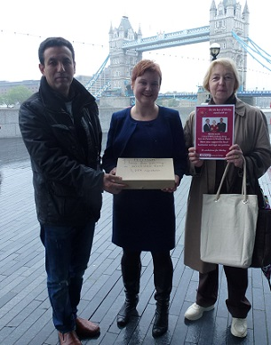 Said Otmani, left, and Marzia Nicodemi, right, at City Hall yesterday with Fiona Twycross accepting the petition on parking in Shirley