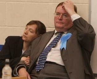 Out for the count: Tory leader Mike Fisher seemed baffled by his election night knock-out