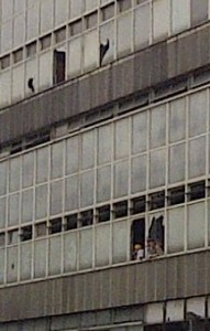 Smashed: East Croydon sorting office this morning, where windows and some of the party-goers appear look smashed