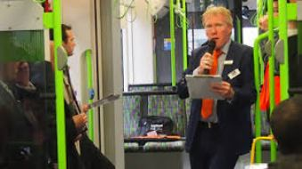 Hold very tight please: Richard Plant conducting a guided tour on a Croydon tram. For SHW? The Whitgift Foundation? Develop Croydon?