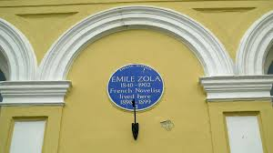 The blue plaque at the Queen's Hotel on Church Road