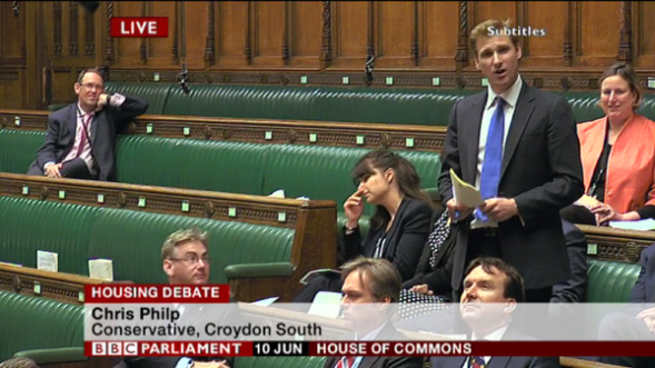 """Hardly a full house: felow MPs """"doughnut"""" around Chris Philp as he makes his maiden speech yesterday"""