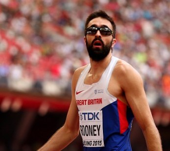 Martyn Rooney looks towards the big screen in the Bird's Nest Stadium to confirm his lifetime best performance