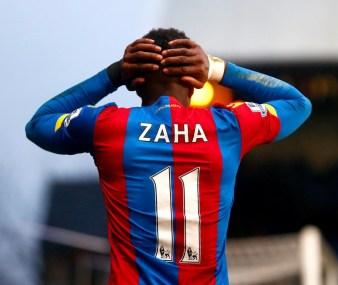 Despair: Wilfried Zaha's body language belies his side's feelings