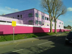 The gigantic pink edifice of the Oasis Arena Academy now dominates the residential streets next to a country park