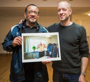 Holger Pooten, right, presents Croydon Photography Forum attendee XXX with his prize print