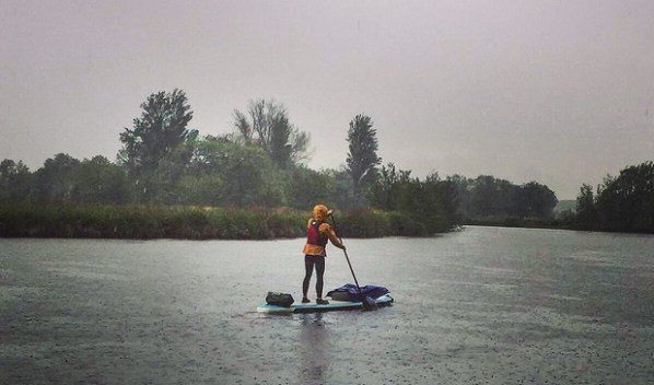 Water, water everywhere... Lizzie Carr got a soaking in the rain on the Thames on the first week of her paddle board challenge, but still completed her 400-mile journey