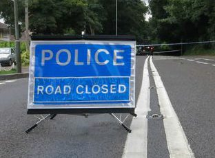 Road closed sign police