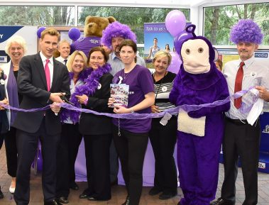 Local MP Chris Philp, second from left (not second from right) cuts the ribbon for the start of Paint Purley Purple