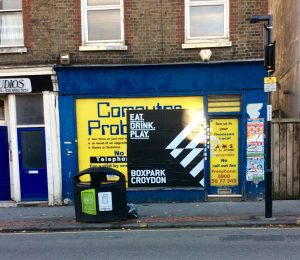 The shop where a council-backed art gallery is to open has been fly-posted