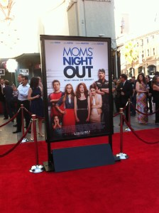 """Moms' Night Out"" poster graces the red carpet during the April 29 premiere in Los Angeles. The film opens nationwide Friday, May 9."
