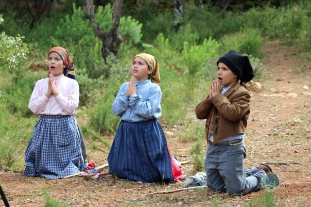 Children kneeling in awe