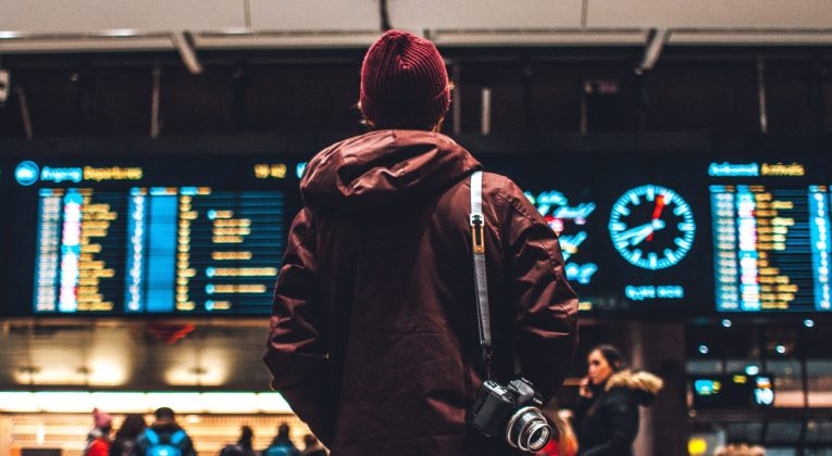 Person looking at departing/arriving flights announcements (Source: Unsplash / Erik Odiin)