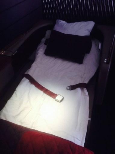 qatar airways, first class, bed