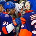 John Tavares congratulates Chad Johnson on the Islanders win over the Carolina Hurricanes
