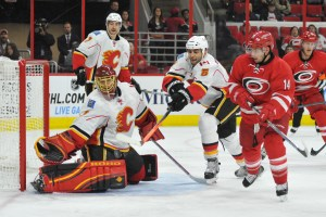 10 Nov 2014 Calgary Flames Goalie Jonas Hiller (1) [6070] tries to find the puck in mid-air during the third period of the game between the Calgary Flames and the Carolina Hurricanes at the PNC Arena in Raleigh, NC. Carolina defeated Calgary 4-1.