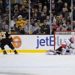 Dec 13, 2014; Boston Bruins left wing Brad Marchand (63) scores on Ottawa Senators goalie Robin Lehner (40) during the shootoutin a NHL game in the TD Garden in Boston. (Photo: Brian Fluharty)
