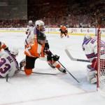 NHL 2015 - Sept 22 - NYR vs PHI - Goalie Magnus Hellberg (#45) of the New York Rangers makes a save against Center Tim Brent (#37) of the Philadelphia Flyers