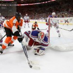 NHL 2015 - Sept 22 - NYR vs PHI - Goalie Magnus Hellberg (#45) of the New York Rangers smothers the puck while playing against Right Wing Wayne Simmonds (#17) of the Philadelphia Flyers