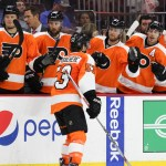 NHL 2015 - Sept 22 - NYR vs PHI - Defenseman Shayne Gostisbehere (#53) of the Philadelphia Flyers gets high-fives from the bench
