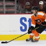 NHL 2015 - Sept 22 - NYR vs PHI - Center Travis Konecny (#80) of the Philadelphia Flyers settles the puck