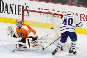 Right Wing Michael Grabner (#40) of the Toronto Maple Leafs scores a goal against Goalie Steve Mason (#35) of the Philadelphia Flyers during the second period