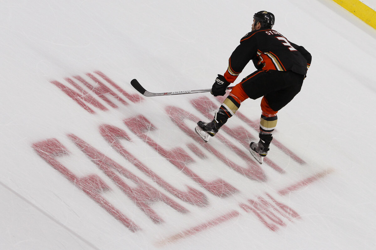 8eefb24d7 Defenseman Clayton Stoner (#3) of the Anaheim Ducks waits for the puck to  be dropped while standing on the Face-Off 2016 logo