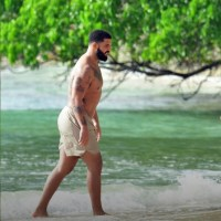 "drake is giving ""thicka than a snicka"" down in barbados"