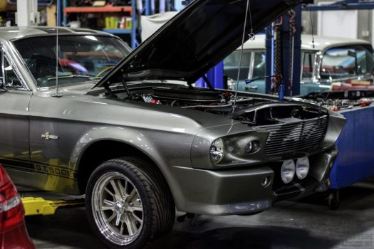 """Shelby GT500E """"Eleanor"""" on a lift at the Engineered Automotive shop."""