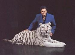 Inside Magic Image of Illusionist Rick Thomas and his White Bengal Tiger