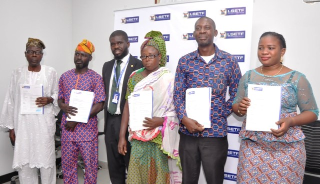 Successful Applicants of Lagos State Employment Trust Fund (LSETF), Mr. Ganiyu Ayantunde; Mr. Abdul Rasheed Olakunle Kazeem; Executive Secretary, LSETF, Mr. Akin Oyebode; Mrs. Sukurat Modupe Alausa; Mr. Charles Chike Obi and Miss Olayemi Zainab Balogun during the distribution of Offer Letters to beneficiaries of the N25 Billion Employment Trust Fund (ETF) Pilot Scheme at the LSETF Office, Oregun, Ikeja, on Friday, December 30, 2016.