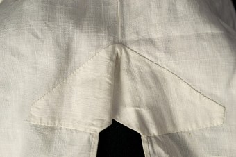 The shirt is reinforced at the top of the side slit. This image shows the interior of the shirt.