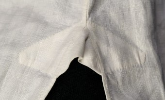 The shirt is reinforced at the top of the side slit. This image shows the exterior of the shirt.