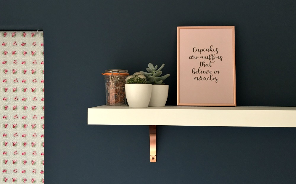 navy wall rose gold brackets on shelf