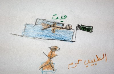 A child's drawing on a development test. The drawing is of what the child wishes to become, a doctor in this case. The patient, however, is already dead.