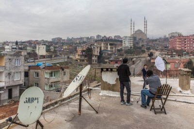 David photographing on the roof of a Syrian school in Kahramanmaras, Turkey, by Mieke Strand