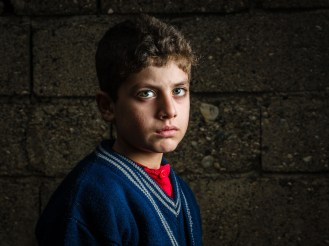 Ramadan, age 11, from Aleppo, is a Syrian refugee child at a the Torches of Freedom Syrian school.