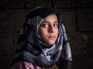 Joud, age 12, from Aleppo, is a Syrian refugee child at a the Torches of Freedom Syrian school.