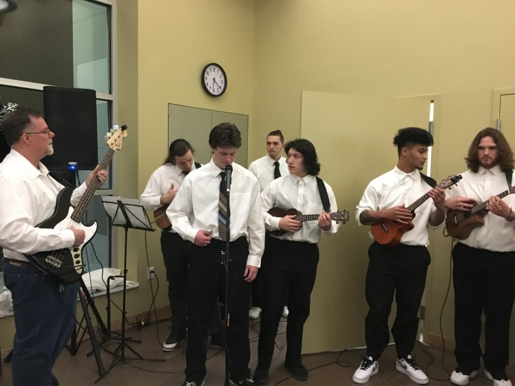 Steve Mounce, a QMHP at Rogue Valley Youth Correctional Facility, leads a group of ukulele players made up of youth at the facility to entertain guests at the Winter Festival.