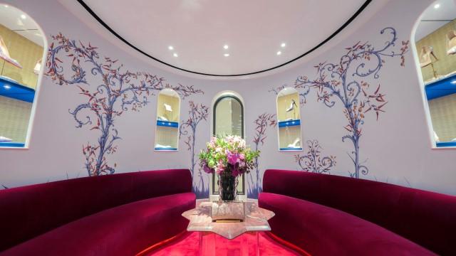 Image of lounges and artistic wallpaper at Christian Louboutin store, Hong Kong