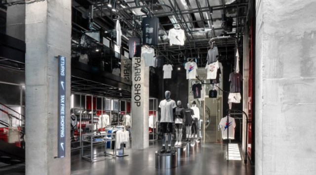 The Nike House of Innovation has high ceilings with product displayed above.