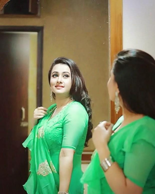 Actress Purnima in green saree