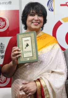 Taslima Nasrin with her Books Photo