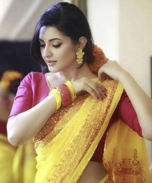 Actress Pori Moni in yollow saree pic
