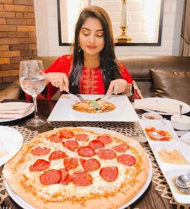 Nusrat Jahan Ontora with foods pic