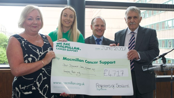 Presentation of cheque to Macmillan Cancer Support