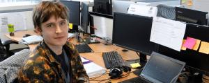 Blazej working at desk