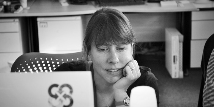 Jennifer working at a desk using a black and white filter