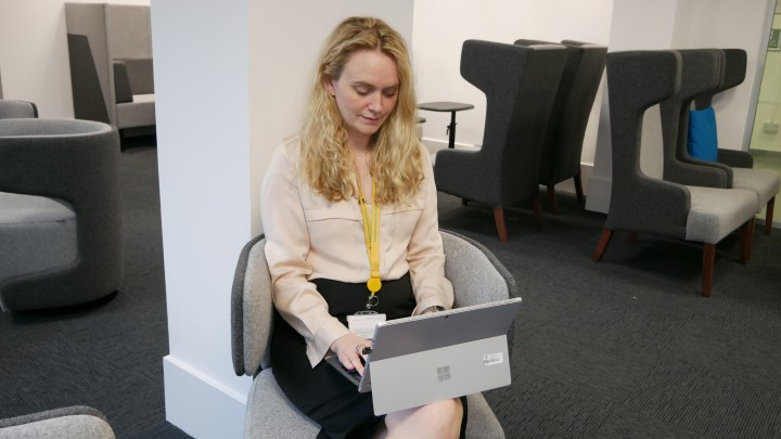 Stef Brown working from laptop